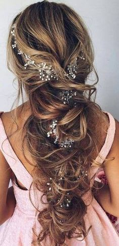 favorite wedding hairstyles for long hair fishtail with flowers