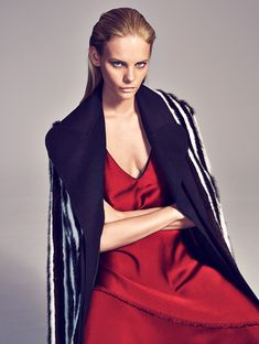 Model wears Sportmax fur coat and red satin dress for Woman Magazine Spain October 2016 issue