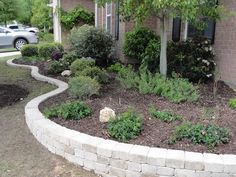 small retaining wall with capstone   Garden with Small Retaining Wall