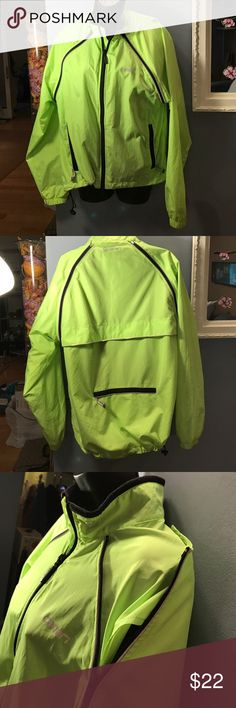 """Unisex reflective running jacket """"canari"""" My husband used to run and only bought the best equipment. Sleeves zip off: back lower zippered pocket 8.75"""" drawstring bottom right. Double zipper in front to zip up or down. Defective color for safety. Zipped up, bust; 21"""" sleeves: 33"""" elastic cuff: 4"""" collar: 2.25"""" with induce fleece. Drawstring waist: 23"""". Top of neck to bottom, front: 23"""". Made of 100% polyester. Very lightweight and breathable with betting inside. Like new. I've never seen him…"""
