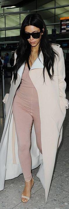 Kim Kardashian: Coat – Balenciage  Pants – Alaia  Shoes – Manolo Blahnik  Sunglasses – Saint Laurent