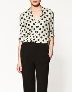 Classic and chic, this blouse is a must have.  Wear it with black trousers and jewel toned, simple shoes and you are good to go.