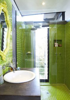Quirky green bathroom. Love the aged concrete vanity top and ornate mirror. House & Leisure