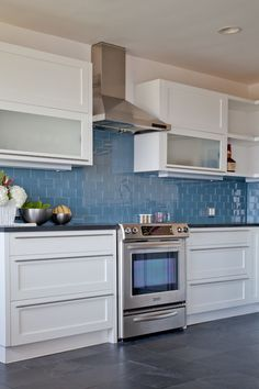LOVE the blue subway glass tile backsplash. Painting my cabinets white...the blue glass would be a beautiful accent!!