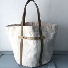 """40's USN heavy white canvas remake bucket style tote bag. I have stenciled """"NELSON.R.W """"on old nametape. IND_BNP_00133_USN W63cm H40cm D38cm Handle55cm"""