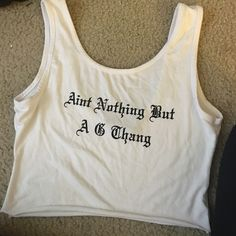 """Ain't nothin but a G thang"" crop White tank top, stretchy material, black letters, it IS cut at the bottom. Forever 21 Tops Crop Tops"