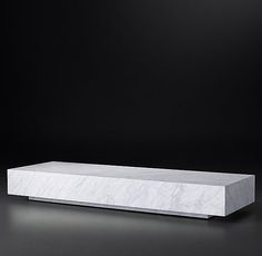 RH Modern's Low Marble Plinth Rectangular Coffee Table:American and Italian design of the 1970s informs our table's proportions and flat planes. Clad in marble, a tracery of natural, silver-grey veining lends each table unique character, while a low, inset base makes this monumental piece appear to float.