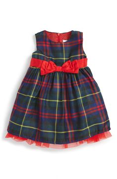 This adorable little party dress is perfect for the upcoming holiday festivities.