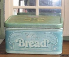 I've always wanted a true vintage bread box, this one is so cute!