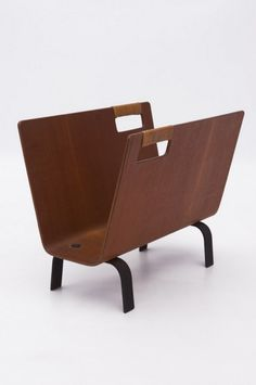 Franco Campo and Carlo Graffi; Molded Teak Plywood, Enameled Metal and Cane Magazine Rack for Home, 1950s.