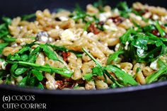 Pasta with sundried Tomatoes, Olives, Garlic, Pine Nuts and Rocket Salad