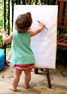 Just the right age to get those artistic brain cells expressing themselves.  #art #children #drawing #easel