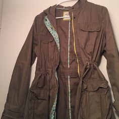 Old Navy army green coat! Such a cute coat. It is long and runs a little big, which means that you can layer away! Cute floral print along zipper line. Old Navy Jackets & Coats Pea Coats