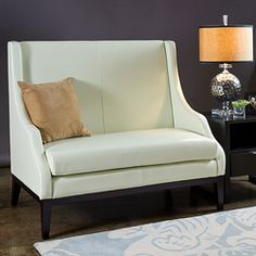 Bring sophistication and class to your living room with the Lummi white leather high-back loveseat. This furniture piece is constructed of wood and dyed top grain aniline leather.