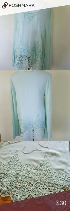 NWOT J.O.A. sage tunic Gorgeous crochet lace detail on this lightweight rayon tunic. Features lace up detail at the chest. Medium size, fits a medium loosely.  The sleeves are long, and would look great folded up with a simple stitch.  It's advertised as sage color, but I'd call it a soft mint color. J.O.A. Tops Tunics