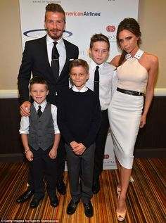 Picture perfect: David and Victoria Beckham turned up to a sporting event in Los Angeles with their three boys, all dressed in matching monochrome outfits