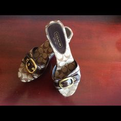 Coach Sandels Shades of brown and tan Coach Sandels !!!! Only worn a few times and in GREAT condition! Size 9 1/2 wedge slip on and very comfortable. Coach Shoes Sandals