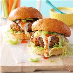 Buffalo Turkey Burgers Recipe -Celery and blue cheese dressing help tame the hot sauce on these juicy burgers. For an even lighter version, pass on the buns and serve with lettuce leaves, sliced onion and chopped tomato. —Mary Pax-Shipley, Bend, Oregon
