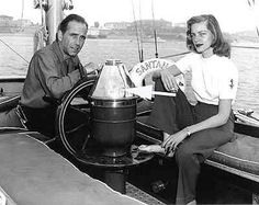 """""""Vintage Photo"""" Lauren Bacall and Humphrey Bogart aboard his 55-foot sailing yacht, the """"Santana"""" The sea was his sanctuary and he loved to sail around Catalina Island as a member of the Los Angeles & Catalina Yacht Club's"""