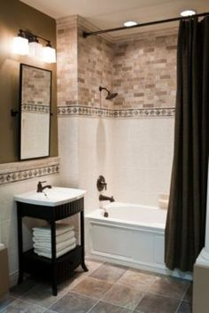 Room Inspiration - Bathroom | All things Tiles! I like how the simple white contrasts with the busy bricks. Might be nice in my large master shower.
