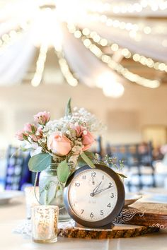 Vintage-inspired wedding centerpieces with clocks, votives and pastel flower arrangements {Monique Hessler Photography}