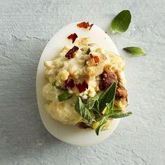 Sun-dried tomatoes, Greek yogurt, and chopped anchovy fillets give Mediterranean Deviled Eggs their distinct flair.