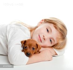 Yooniq images - blond kid girl with mini pinscher pet mascot dog on white background