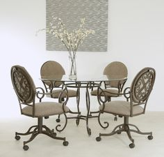 Beautiful glass top swivel tilt caster dinette set by Pastel Furniture. Available at www.disocuntdinettes.com.