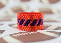 Ring Design: Broncos Fan  This is a beaded ring made with the peyote stitch. The…