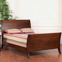 Amish Made Solid Wood Craftsma Manhattan Panel Bed & Headboard. Classic And durable bed suitable for all and any home decor! Add favorite pillows and blankets to personalize and enjoy a good night's sleep.