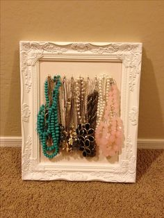 Hm. Maybe wood in a frame with the little hooks? I like that it doesn't have to attach to the wall.