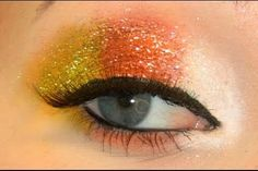Create a simple but festive candy corn look with glitter and eye shadow.