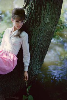 Audrey Hepburn by the river near her villa just outside Paris, 1962. Photo by Bob Willoughby