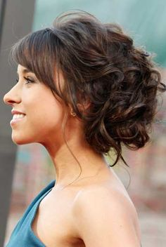 Curly Bun... needs like a jewel or bow or flower to be a wedding style though