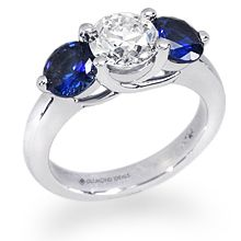 This customized three stone trellis ring features 2 stunning sapphires flanking a 1 carat round diamond. All custom rings are created around the stone of your choice and priced individually. Thing 1, Proposal Ring, 1 Carat, Sapphire Diamond, Trellis, Round Diamonds, Diamond Engagement Rings, Wedding Rings, Stone