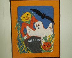 This Halloween Wall Hanging is quilted with 100 % Cotton Fabric. It measures 18 x 21 1/2. It has a layer of cotton batting and is machine quilted. The back is black with tiny orange moons and stars. There is, also, a special sewn area on back to insert dowel for hanging.