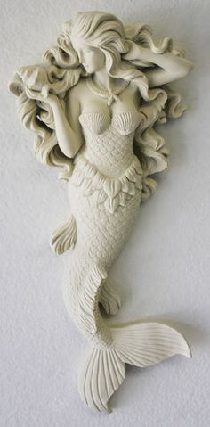 And I love it for my coastal home! Gorgeous mermaid, of beauty of the sea, wall figurine in off-white adds a bit of charm to your beach cottage or coastal themed room. Brant Point Lighthouse, Cerámica Ideas, Mermaid Bathroom, Do It Yourself Inspiration, Mermaids And Mermen, Mermaid Art, Fat Mermaid, Mermaid Statue, Mermaid Wall Decor
