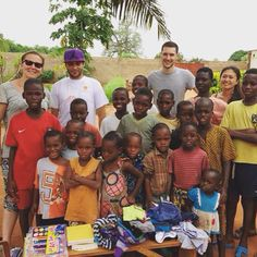 Kailend volunteers donating books and clothing to the children at Vogan orphanage