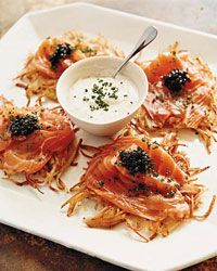 Potato Pancakes with Smoked Salmon, Caviar and Dill Cream   Although Wolfgang Puck is best known for putting smoked salmon, caviar and dill-flecked crème fraîche on his designer pizzas, he also loves this trio of toppings with his exceptionally crispy potato pancakes.
