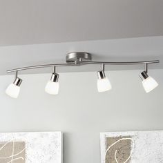 Replace your outdated florescent light box in your kitchen to prepare your home to sell it.  Style Selections 4-Light Brushed Nickel Fixed Track Light Kit at Lowes.com $39.98