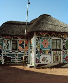 Inside the Beautifully Graphic Painted Ndebele Homes in South Africa is part of Beautiful home South Africa - The intricate paintings—representing everything from prayers to marriage announcements—originated in the century Vernacular Architecture, Art And Architecture, Architecture Details, Beautiful World, Beautiful Homes, African House, Mud House, Art Nouveau, Africa Art
