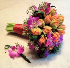 Beautiful tulip bouquet which will continue to grow once placed in water. Designed by Ovando of NYC. #tulips #bouquet