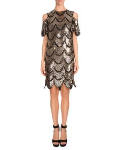 Givenchy: Sparkle the night away in a gold/black embellished cold shoulder dress with scalloped details.
