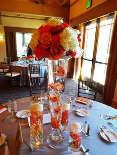 Classic Formal Modern Romantic Ivory Orange White Centerpieces Country Club Fall Flowers Hydrangea Indoor Reception Nevada Orchid Ranunculus Rose Tulip Wedding Reception Photos & Pictures - WeddingWire.com