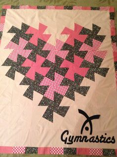 Love Gymnastics. Twister ruler heart quilt with our gym logo appliqué.  Prize for top fundraisers in our annual cartwheel-a-thon.  By Dawn