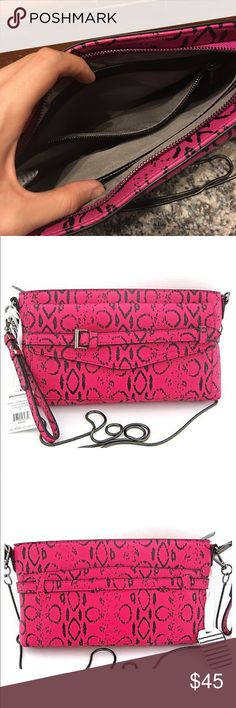 Reed Limited Edition Boxer Clutch Mini Crossbody Reed Limited Edition Boxer Clutch Mini Crossbody. Brand NEW with tags!  Pink and black with an awesome metal chain! Reed Bags Crossbody Bags
