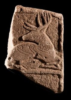 """irisharchaeology: """" Celtic Deer A seated stag, its legs doubled up underneath its body, ornamented with conventional spirals. Carved in stone, it dates from 9th century AD and is from Angus, Scotland Source """""""