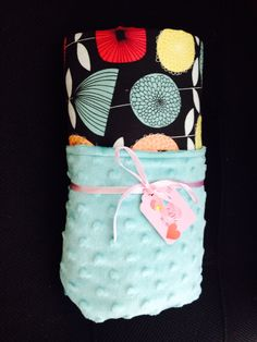 Cute floral and turquoise minky baby girl blanket.
