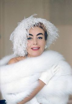 Joan Crawford (1905-1977), US actress, wearing white ostrich feather hat