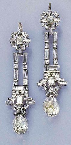 A PAIR OF ART DECO DIAMOND EAR PENDANTS Each designed as a baguette and square-cut diamond flexible band of geometric motif suspending a briolette-cut diamond, circa 1925 - exquisite Art Deco Earrings, Art Deco Jewelry, Fine Jewelry, Jewelry Design, Drop Earrings, Chandelier Earrings, Gemstone Earrings, Statement Earrings, Diamante Art Deco